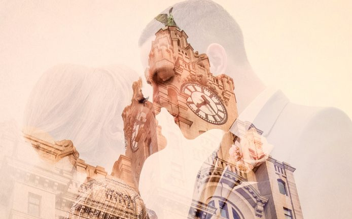 double exposure of bride and groom about to kiss and liver building liverpool